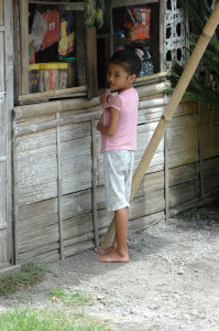 Philippines mindanao girl in front of sari sari store